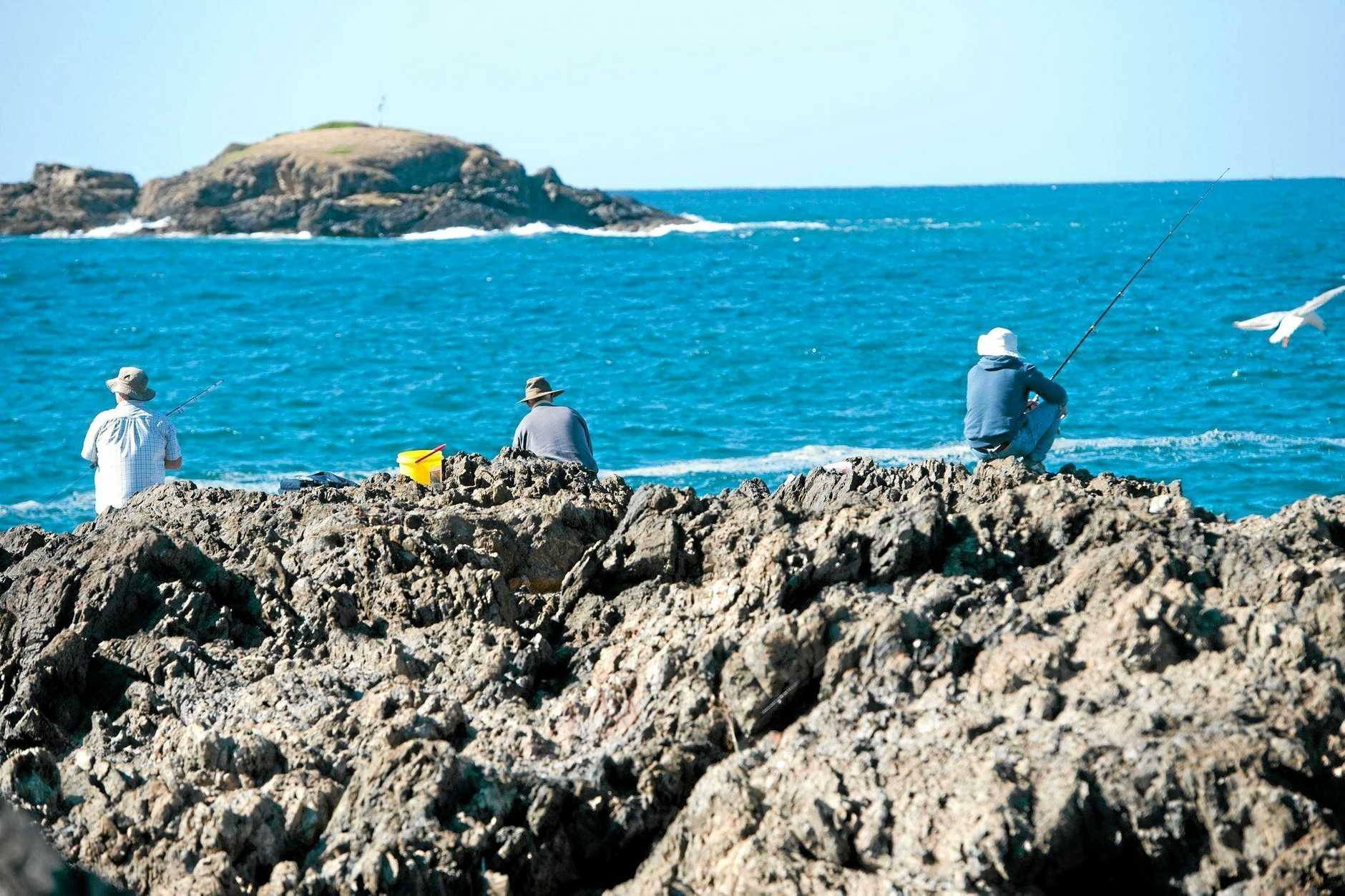 Rock fishing remains a popular pastime. Life jackets are not so popular.