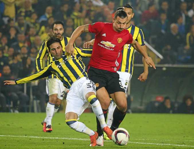 Manchester United's Zlatan Ibrahimovic dribbles past Fenerbahce's Hasan Ali Kaldirim during a Europa League match.