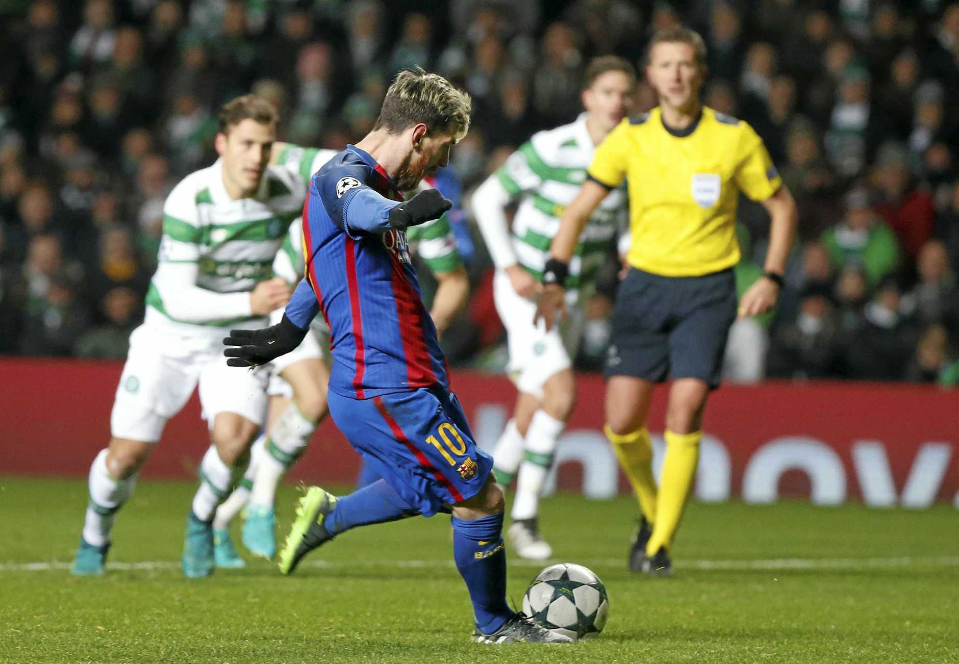 Barcelona's Lionel Messi scores from a penalty during the Champions League Group C soccer match against Celtic.