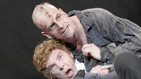An image from Frankenstein by the British National Theatre (2011 production) with Jonny Lee Miller as The Creature and Benedict Cumberbatch as Victor Frankenstein.