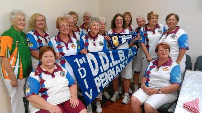 South Toowoomba celebrates a long-awaited Darling Downs Ladies Bowls Association Division 1 Pennants triumph. From left to right: DDLBA president Elsie Voll, Christine Ward, Sandy Beresford, Gaye Wilmott, Kay Hewitt, Ros Byers, Brenda Shea, Maureen Edwards, Marlene Hannant, Meredith Taylor, Judi Holmes, Maureen Pyne, Deb Petersen. Seated Shirley Green and Bonnie Gordon.