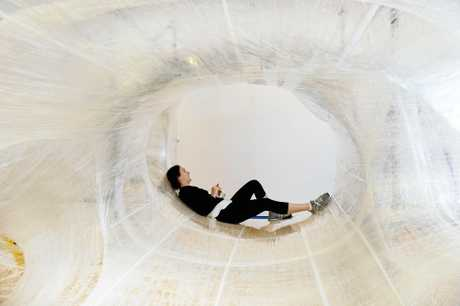 A helper working on the new tape sculpture at the Ipswich Art Gallery takes a break.
