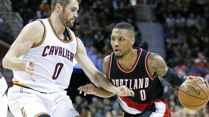 Portland's Damian Lillard tries to get past Cleveland's Kevin Love.