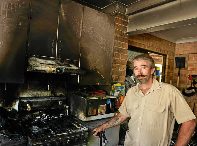 NEAR DISASTER: Jason Long in the kitchen that almost burned down in a cooking fire which might have destroyed his mother's Wolvi home.