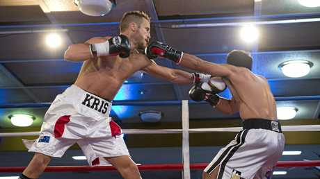 IN ACTION: Toowoomba boxer Kris George fights Fernando Da Silva for the WBA Oceania light welterweight title in Toowoomba in October , 2014.