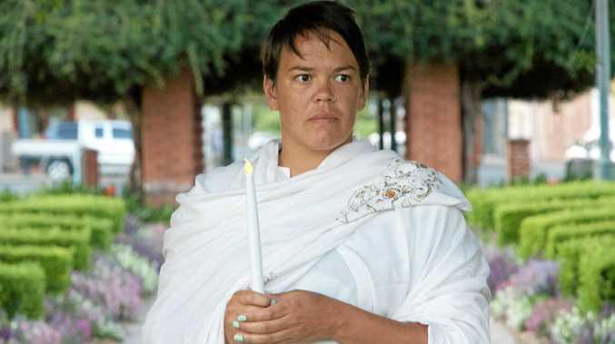 Rachael Cavanagh prepares for the White Ribbon Day vigil at Memorial Park.