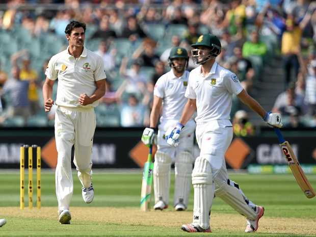Australian bowler Mitchell Starc celebrates after dismissing South African batsman Stephen Cook for 40 on day one of the third Test at the Adelaide Oval.