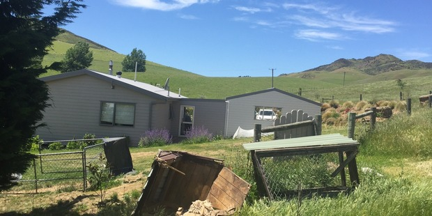 A Scargill family's home has been abandoned after a dislodged boulder rolled through their dog kennel and now they fear more boulders could destroy their house. Photo / Kurt Bayer