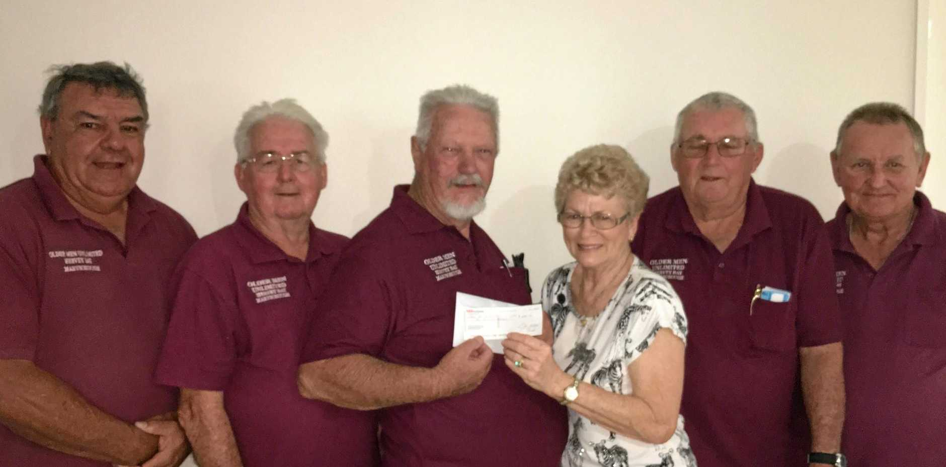 Quota Maryborough president Val Harvey presented $400 to the Older Men Unlimited Group members (from left) Glen Miller, Frank Grant, Theo Svensen, Val Harvey, Peter Sawtell and Ian Wies.