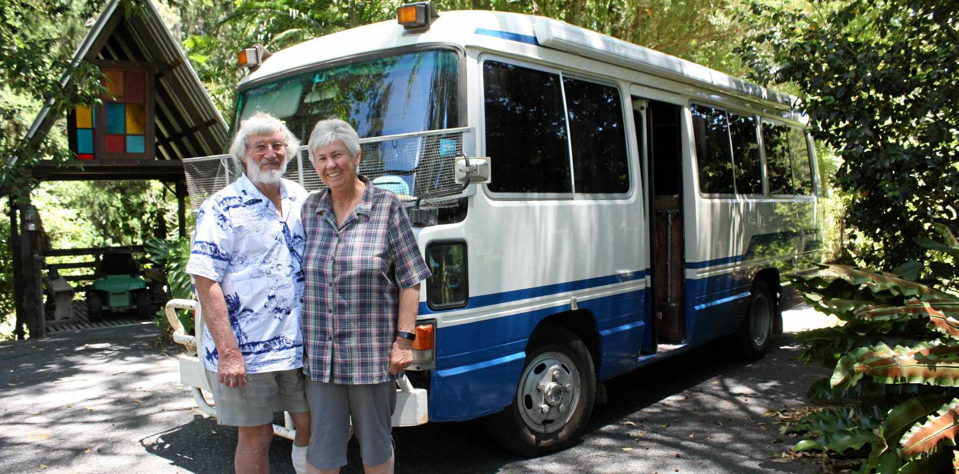 ON TOUR: Peter and Pam Fraser with their trusty motor home, a converted Coaster bus.
