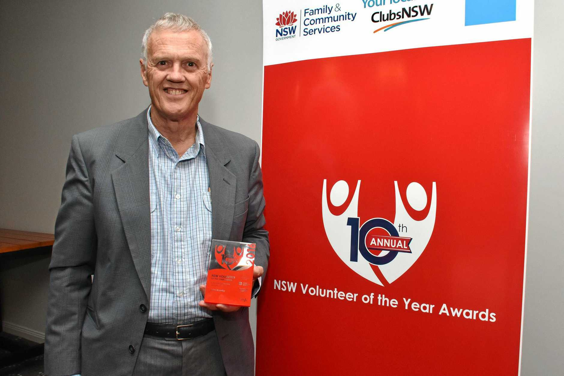 John Brumby receiving his awards for Mid North Coast Volunteer of the Year and Senior Volunteer of the Year for 2016.