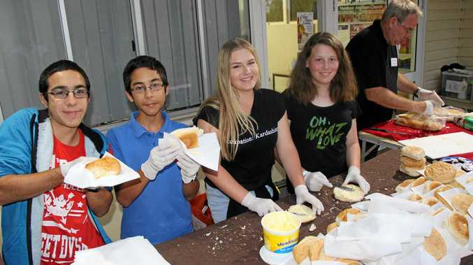 ON A ROLL: Valentino and Dante Grosso, Jade McCloskey and Jesica Sim serve up hot hamburgers.