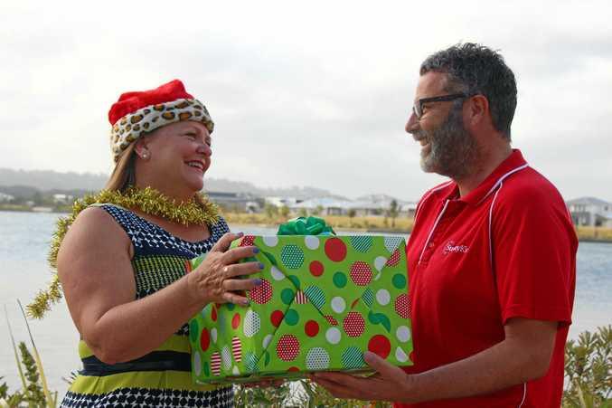 SPIRIT OF GIVING: Kawana Chamber of Commerce president Linda Delamotte gives SunnyKids CEO Chris Turner the opportunity to help kids this Christmas.