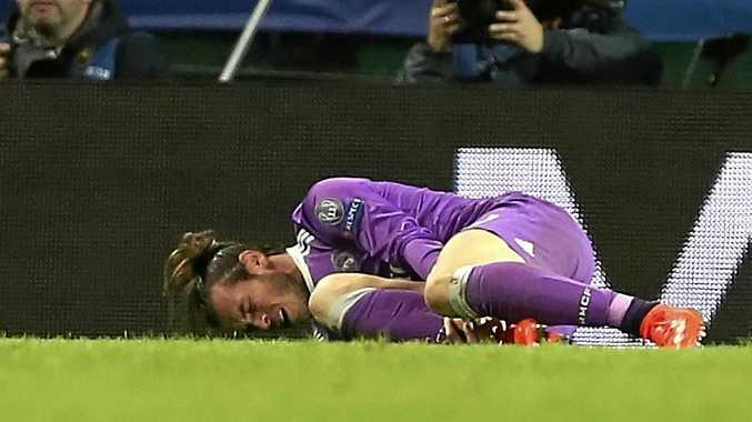Real Madrid's Gareth Bale reacts after being injured during the Champions League Group F soccer match against Sporting Lisbon.