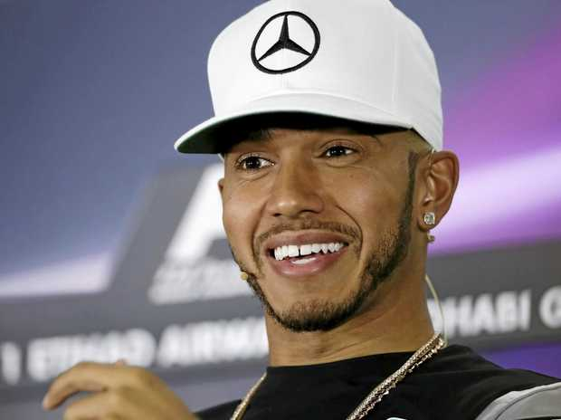British Formula One driver Lewis Hamilton of Mercedes smiles during a press conference in Abu Dhabi.
