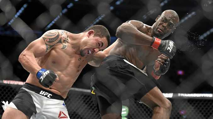 Robert Whittaker (left) fights Uriah Hall during their UFC 193 middleweight bout in Melbourne last year.