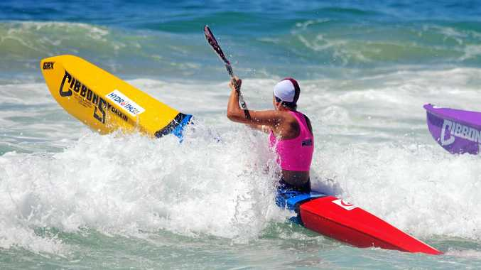 IN ACTION: Noosa's Lana Rogers challenging the surf in the ski leg of an under-19 ironwoman race at Freshwater.