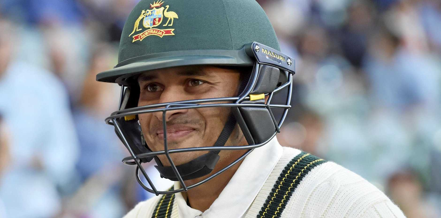 Usman Khawaja is all smiles after scoring a ton at the Adelaide Oval.