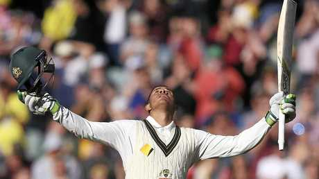 Australia's Usman Khawaja celebrates making 100 runs.