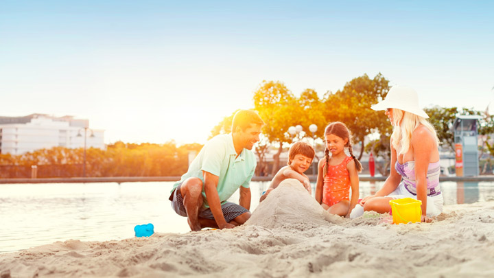 See how this family is not under the shade of a beach umbrella? That's because they're banned.