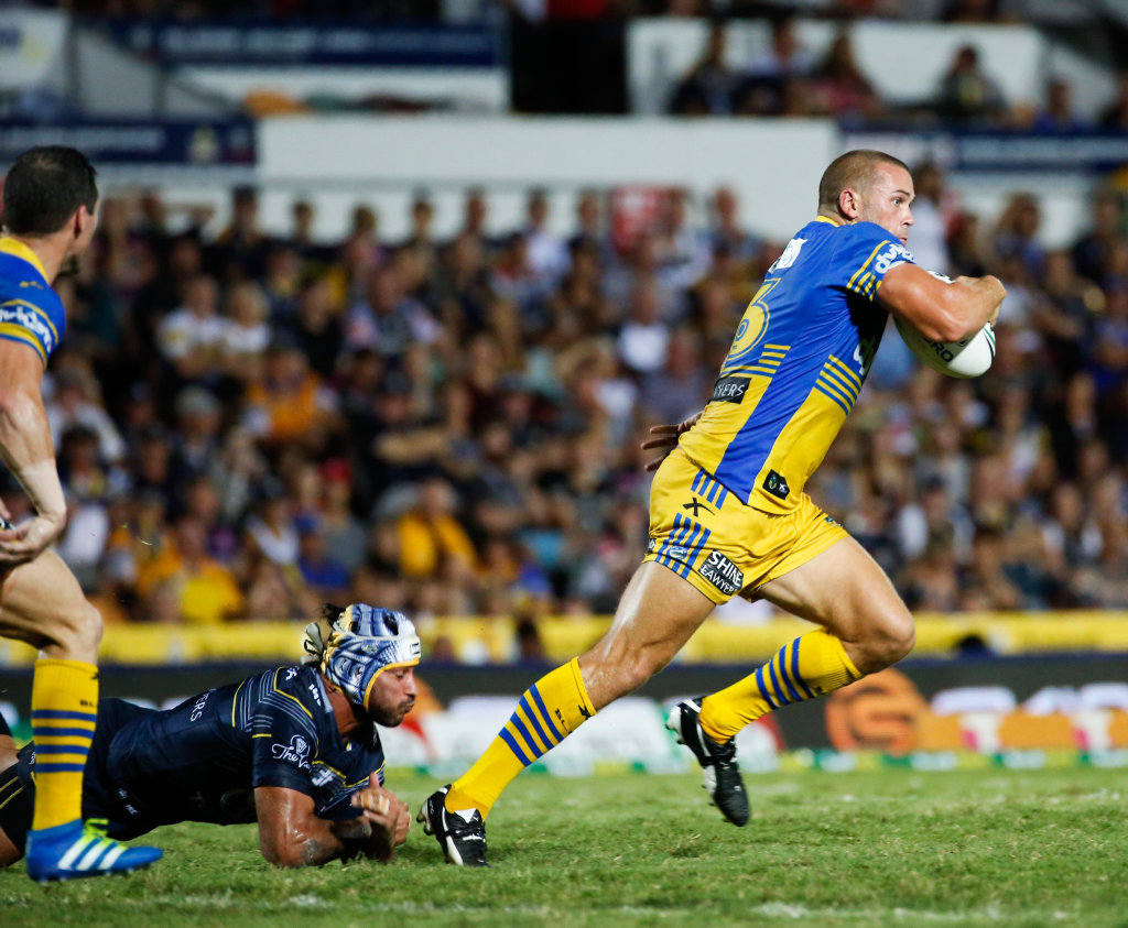Eels Danny Wicks makes a break from the tackle of Cowboys co-captain Johnathan Thurston during the round 8 NRL match between the North Queensland Cowboys and the Parramatta Eels at 1300 Smiles Stadium in Townsville, Saturday, April 23, 2016.