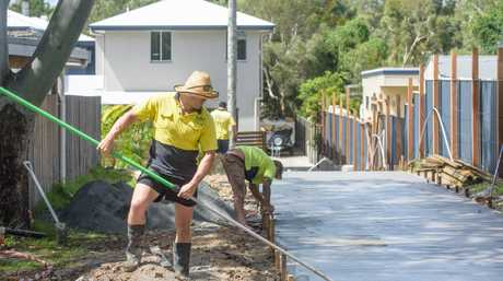 Former Parramatta Eels player and now Grafton Ghosts captain coach Danny Wicks works on a concreting job in Yamba.