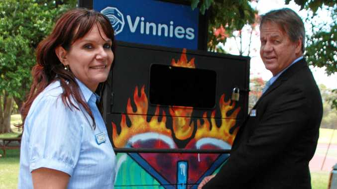 TOP BIN: Vinnies youth engagement and development officer Julie Inskip (left) and Downlands College principal Stephen McIllhatton inspect the new and creative Vinnies donation bin at the school.