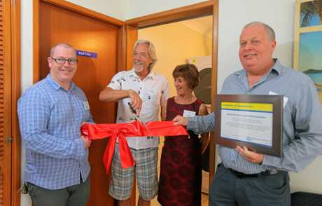 John Callanan opens the refurbished Fred's Place laundry room at Tweed Heads in 2015 while Yvonne Wynen, Jason McDonald and Chris Hughes help out.