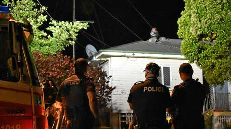Police are in negotiations with a man wanted on a return to prison warrant who has camped himself on a roof in Mt Pleasant Rd.