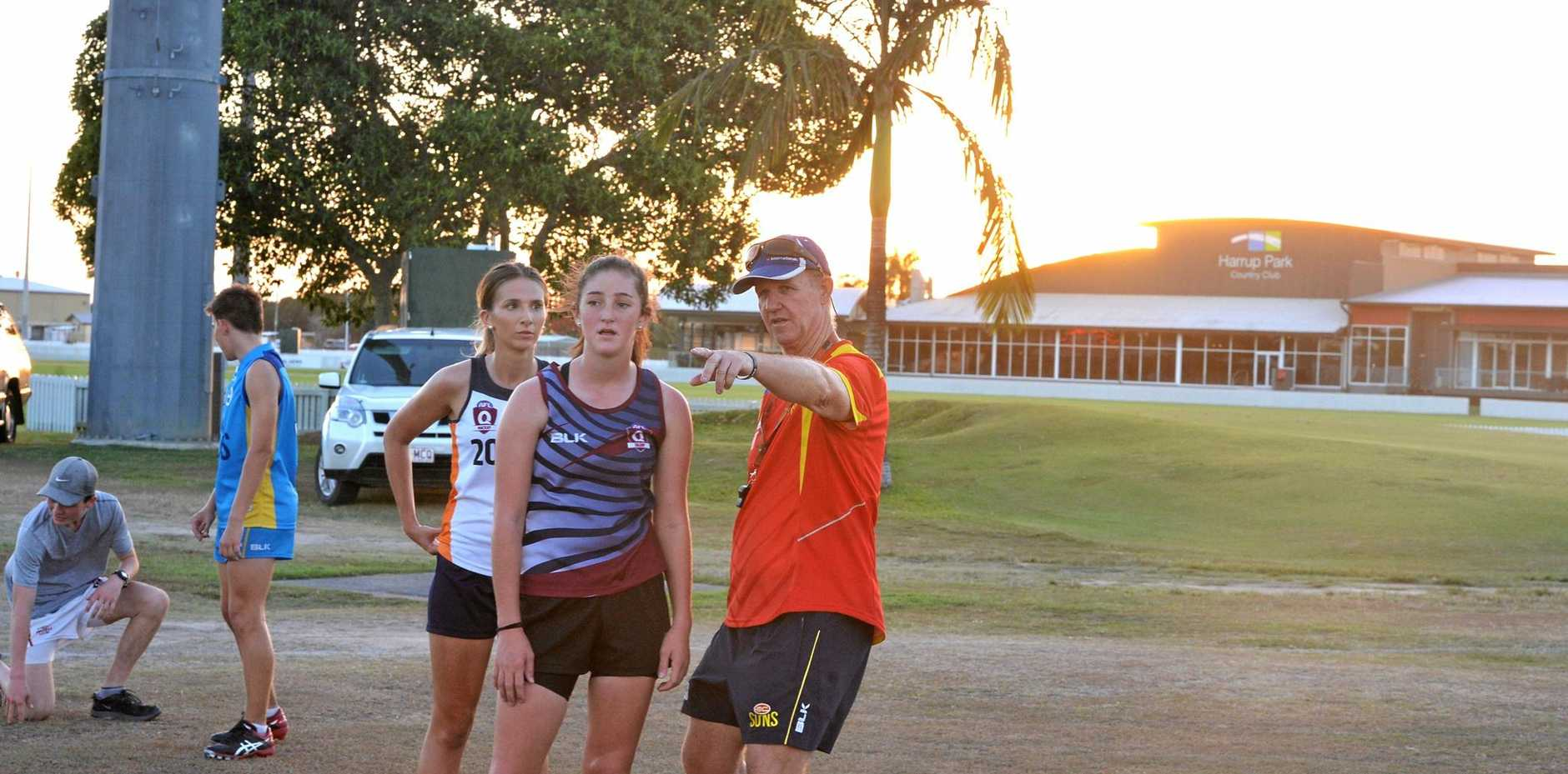 The new AFL Mackay president Gary Downes coaching at the Gold Coast Suns Academy.