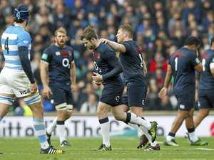 England overcomes sending-off to down Pumas
