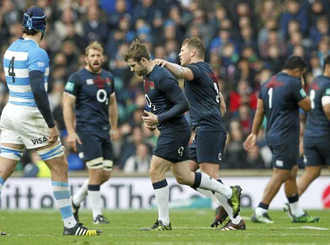 England's Elliot Daly goes off the pitch after being sent off for dangerous play against Argentina.
