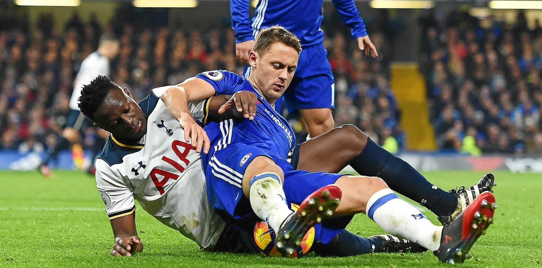 Chelsea's Nemanja Matic and Tottenham's Victor Wanyama fight for the ball.