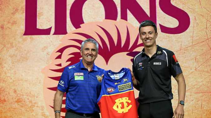 Brisbane Lions head coach Chris Fagan with No.3 draft pick Hugh McCluggage.