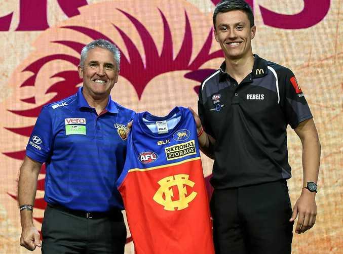 Brisbane Lions head coach Chris Fagan with No.3 draft pick Hugh McCluggage.