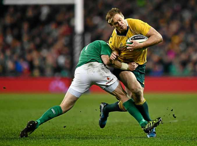 Dane Haylett-Petty of Australia is tackled by Keith Earls of Ireland.