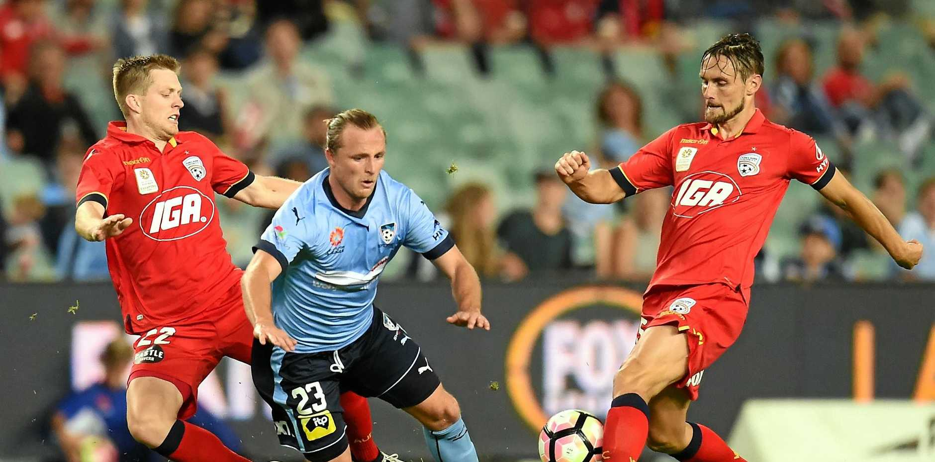 Sydney FC's Rhyan Grant is tackled by Adelaide's Ryan Kitto during the sides' goalless draw.