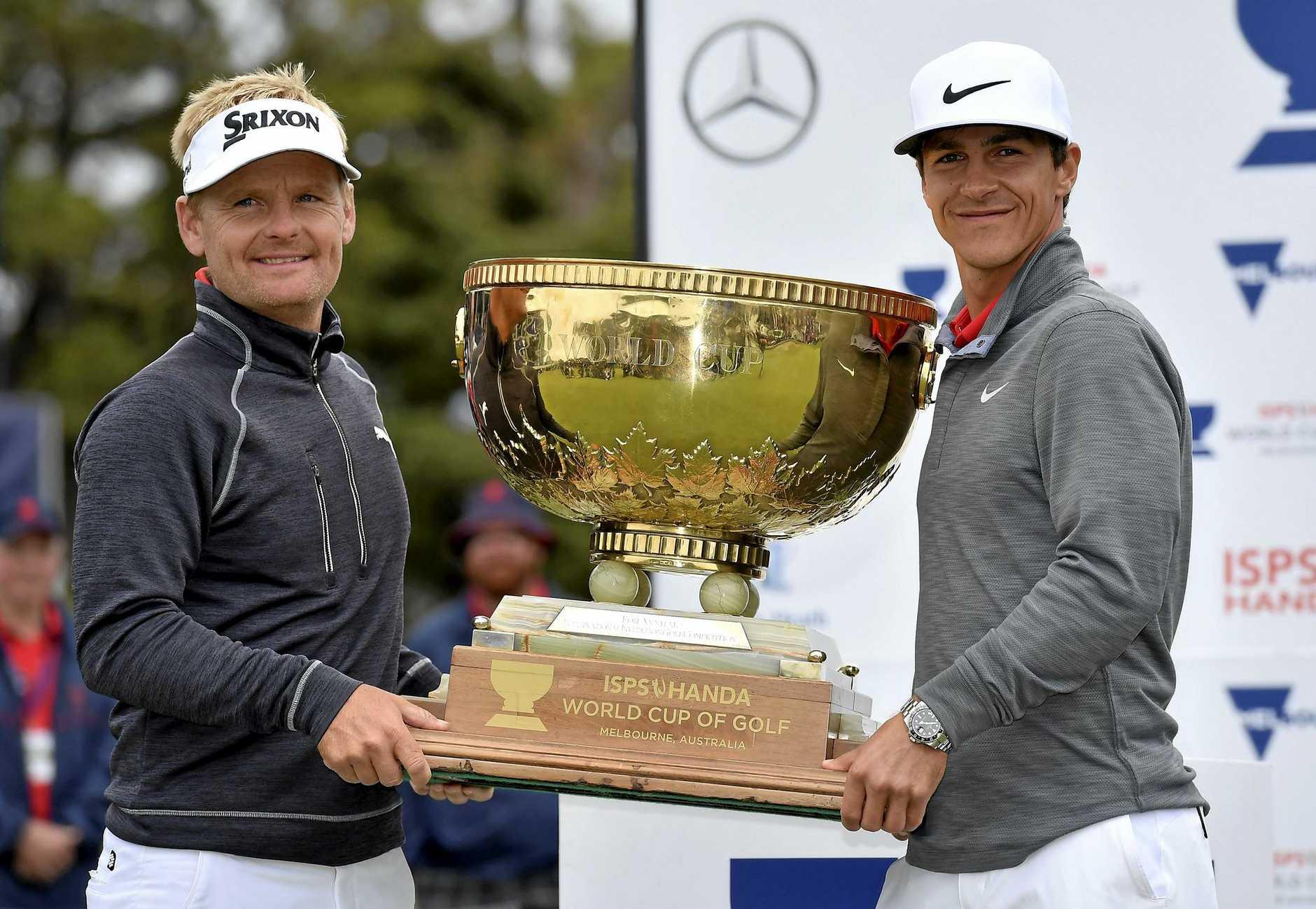 Denmark's Thorbjorn Olesen (right) and partner Soren Kjeldsen hold the World Cup of Golf trophy at Kingston Heath in Melbourne.