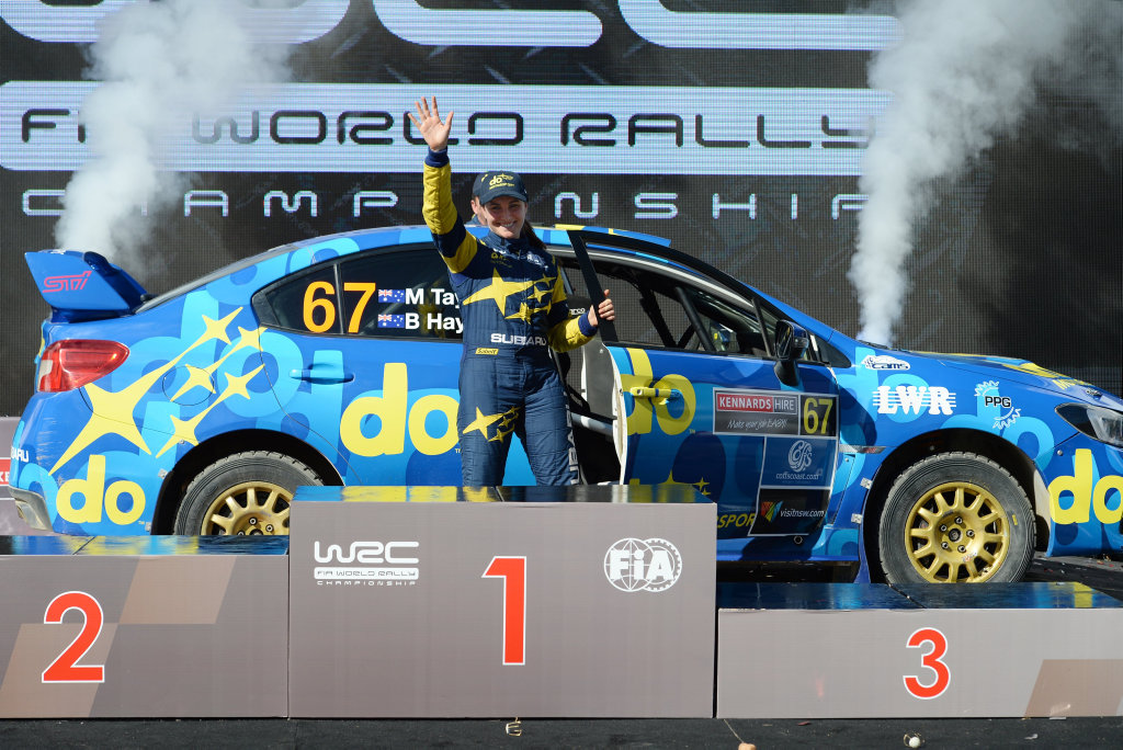 In an image acquired Sunday, Nov. 20, 2016 shows driver Molly Taylor celebrates on the podium during the Kennards Hire Rally Australia competition at Coffs Harbour, Australia. (AAP Image/PR IMAGE/RALLY AUSTRALIA) NO ARCHIVING, EDITORIAL USE ONLY