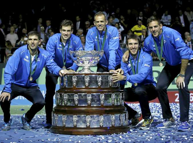 Argentina's players pose with the trophy after winning the Davis Cup final in Zagreb.