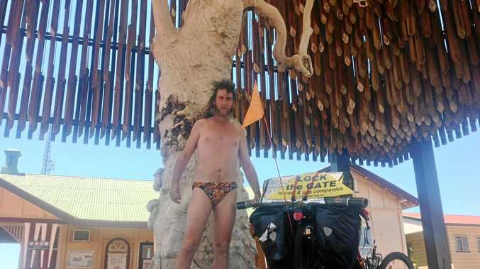 Bogan with a Slogan aka Christopher Horton shows off his bespoke 'Budgy Smugglers' at the Tree of Knowledge in Barcaldine.