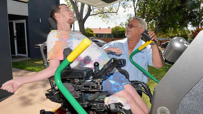 BEST IN THE BUSINESS: Taxi Council Queensland 'Driver of the Year' William Paul helps passenger Anthony Austin into his cab.