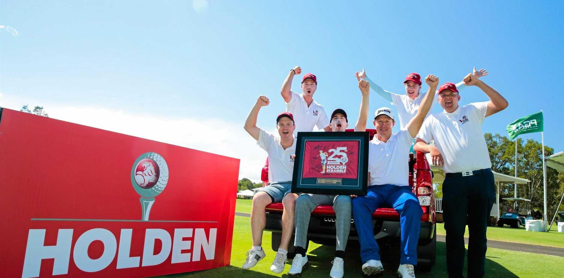 YOU BEAUTY: A team from Wentworth Golf Club won the final of the Holden Scramble.