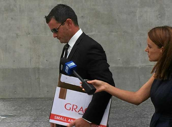 Accused murderer Shane Anthony Eric Hansen leaves the Brisbane Supreme Court.