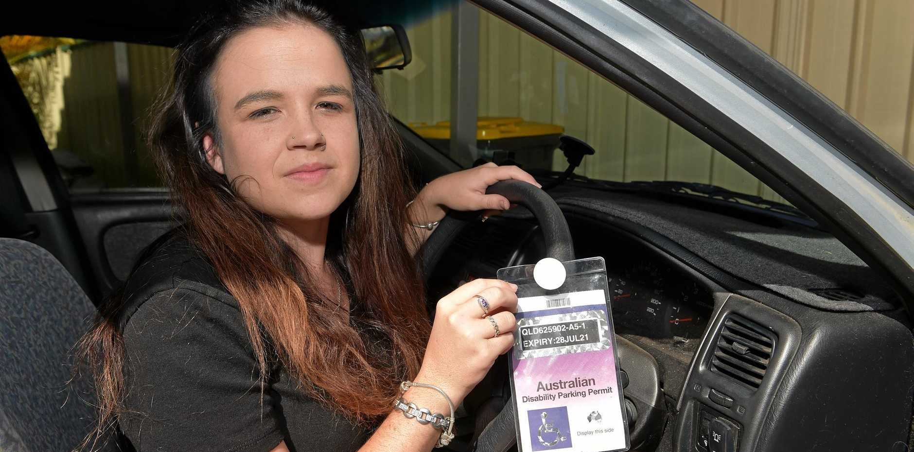 Mikaela Peters is able to use a disabled parking permit despite some people not thinking she is 'diasbled enough'.