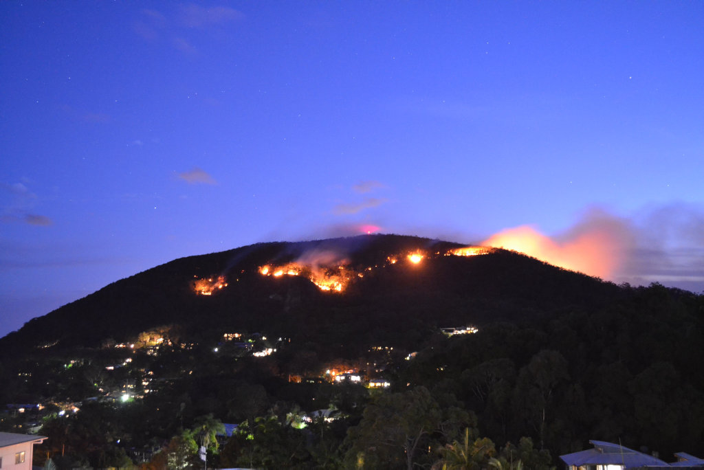 Fire burn in bushland on Mt Coolum about 7.30pm on November 28, 2016.