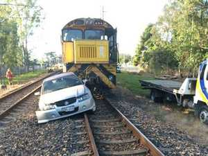Police search for car thief who caused train crash