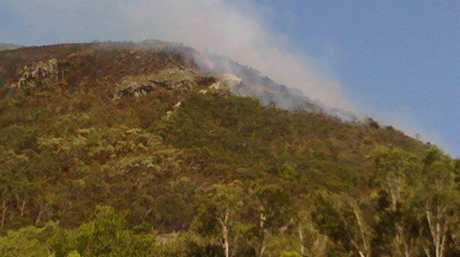 The fire on Mount Coolum continues to burn this morning.