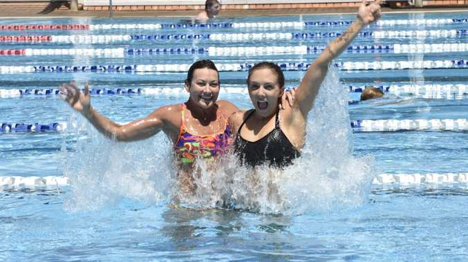 Haley McDonald and Marci Mathiesen cooling down in Milne Bay Aquatic Centre in preparation of hot temperatures this week.