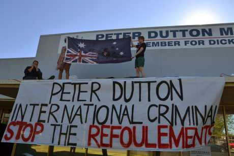 Supplied image of (L-R) Brisbane women Scarlett Squire, Kelly Purnell and Ellen Sargent, who climbed onto the roof of the electoral office of Federal Minister for Immigration and Border Protection Peter Dutton in protest in Brisbane, Wednesday, Nov. 2, 2016. The women say they're offended by the Turnbull government's plans to ban all adults sent to offshore immigration centres on Nauru and Manus Island from ever entering Australia, regardless of whether they're found to be refugees or not. (AAP Image/Scarlett Squire) NO ARCHIVING, EDITORIAL USE ONLY